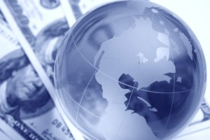 A globe and cash close up